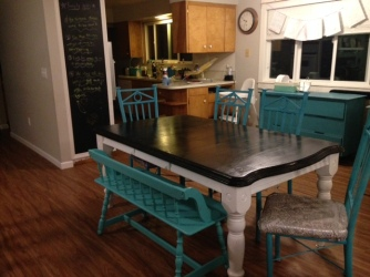 The table Scott had before we were married that I refinished. Notice the seats that are recovered.